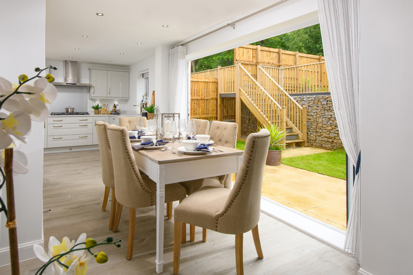 Allendale kitchen with dining area and bi-fold doors opening onto garden