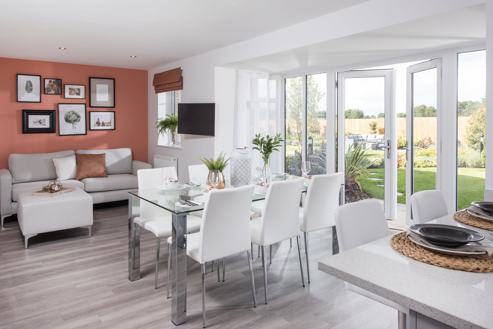 Open-plan kitchen diner and family area with glazed bay