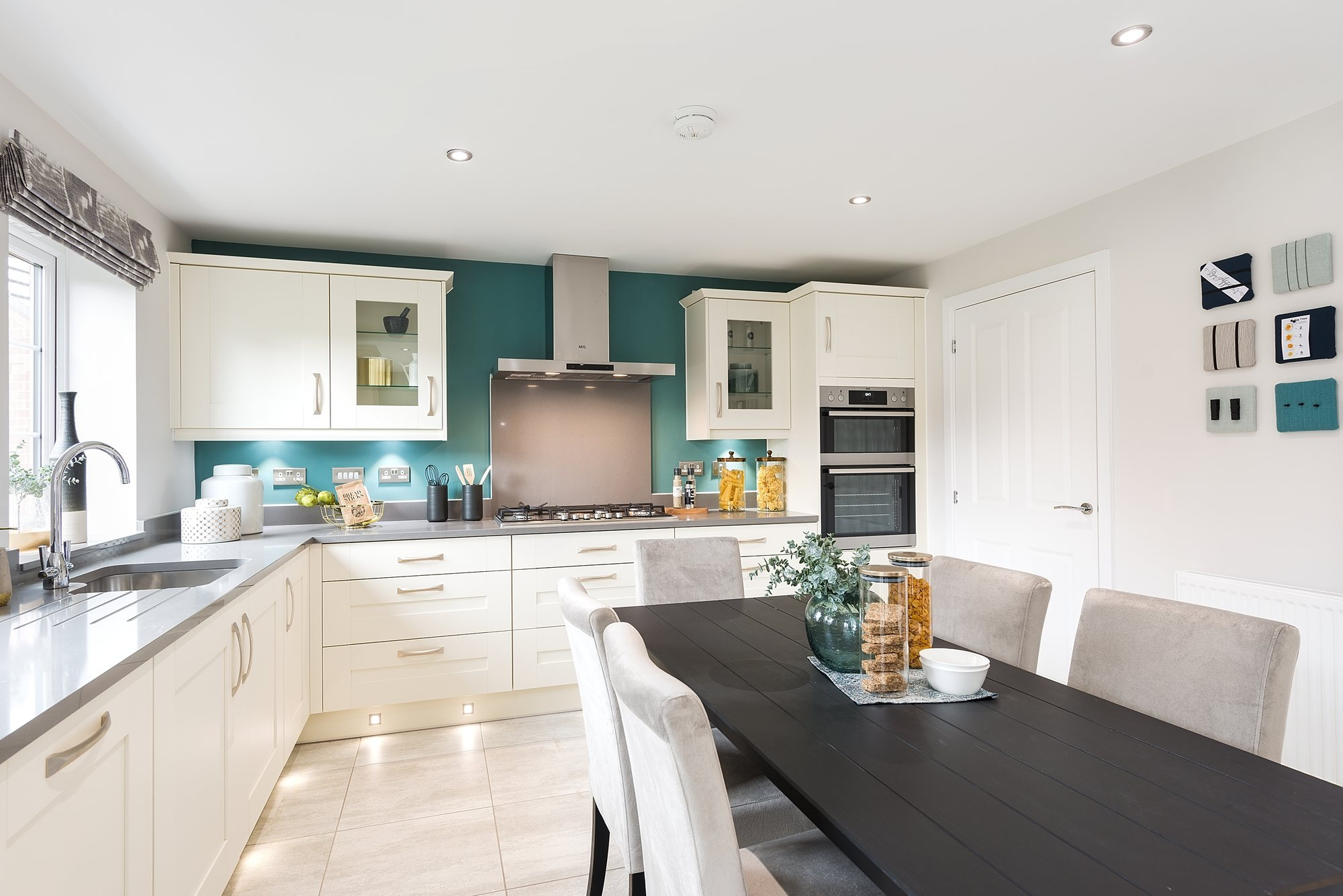Open-plan kitchen with breakfast/family areas and French doors