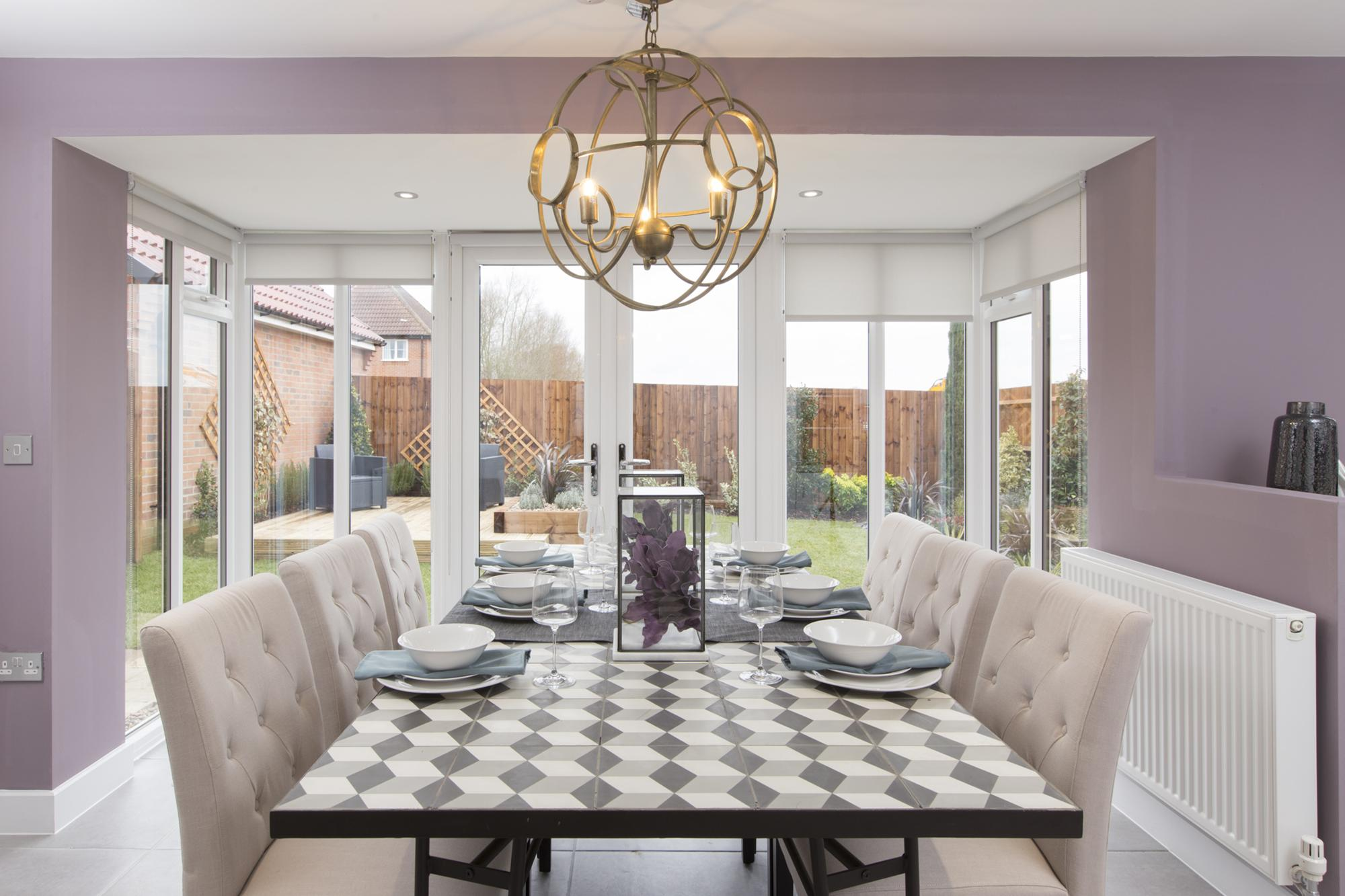 Kitchen dining area with glazed bay and French doors