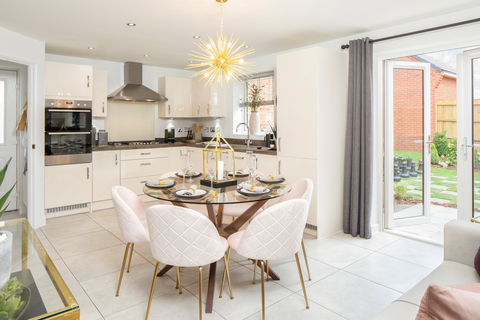 Open plan kitchen / dining room with french doors to the garden in the Irving 4 bedroom detached home