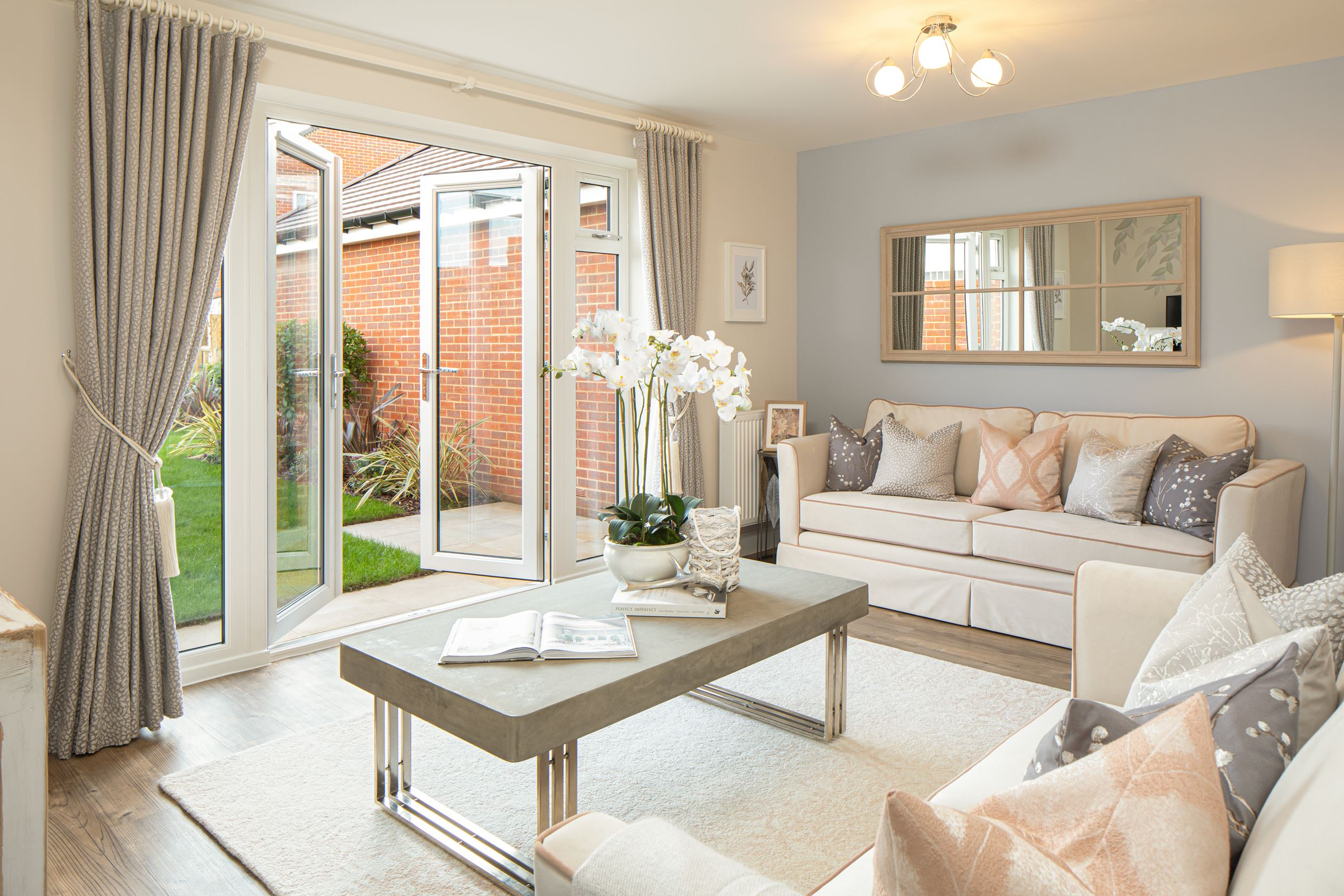 Spacious lounge with french doors to the garden in the Ashurst 3 bedroom home