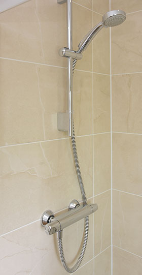 Conventional shower fitting